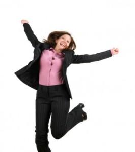 woman jumping pink blse